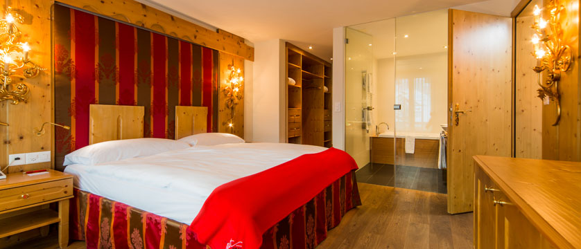 Hotel Ferienart Resort & Spa, Saas-Fee, Switzerland - Double bedroom with bathroom.jpg